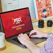 Man Working on Macbook Mockup PSD