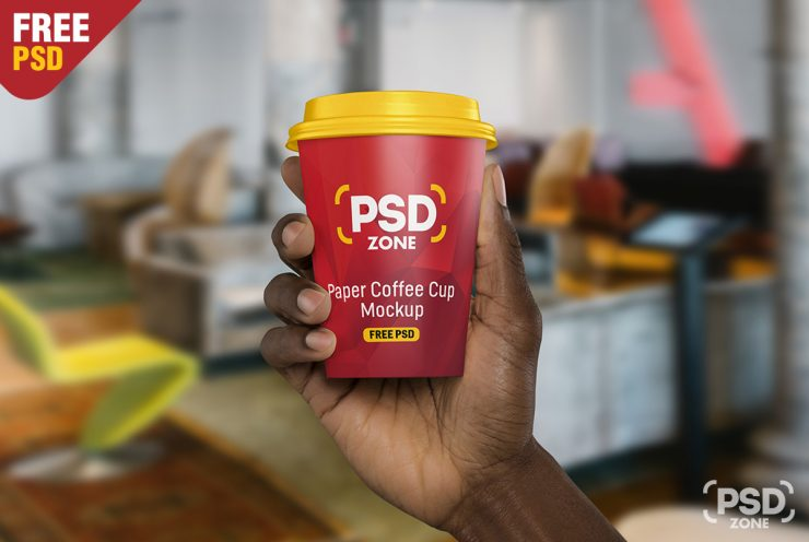 Hand Holding Paper Cup Mockup PSD