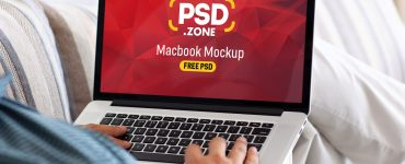 Man Typing on Macbook Pro Mockup PSD