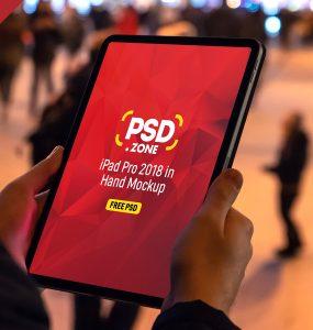 iPad Pro 2018 in Hand Mockup Free PSD