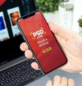 Man Holding iPhone X Mockup PSD