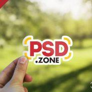 Hand Holding Sticker Mockup PSD